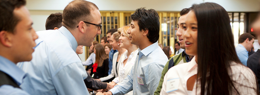 business and economics students at networking event